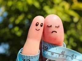 44225155 - finger art of couple with meter. the concept man is thin, woman is fat.